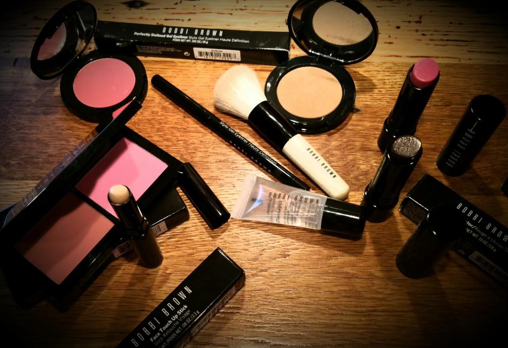 Bobbi Brown Cosmetics, featuring Crystal Lip Gloss, Sheer Lip Color in Magenta and Crystal Pink, Aruba Illuminating Bronzer, Face Blender Brush, and Gel Eyeliner