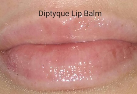 Diptyque L'Art Du Soin Lip Balm swatched on lips - with flash