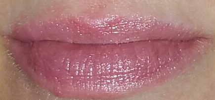 Coola Mineral Liplux SPF 30 in Summer Crush swatched on lips with flash