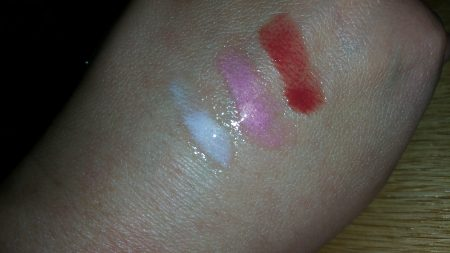 Colorescience Sunforgettable Lip Shine SPF 35 - Clear, Pink, and Siren (left to right) - swatched on hand - flash