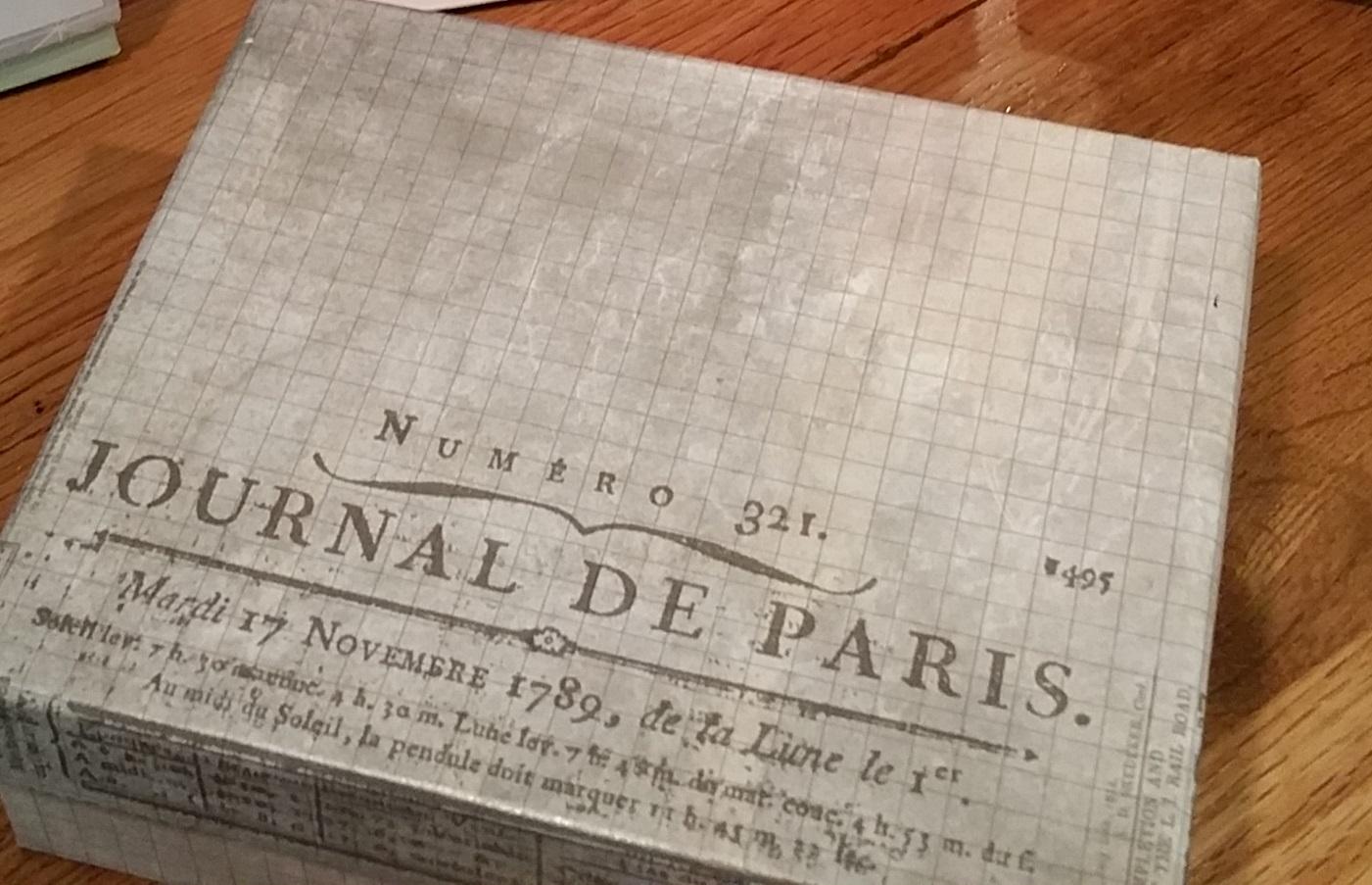 A box I covered using scrapbook paper.